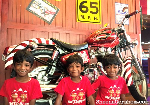 Kids posing with a abike